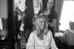 Bride's hair fixing by hairstylist | Anne Lord Photography