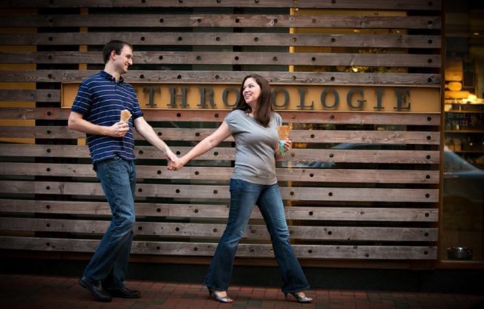 Couple holding hands with wooden wall on the background | Anne Lord Photography