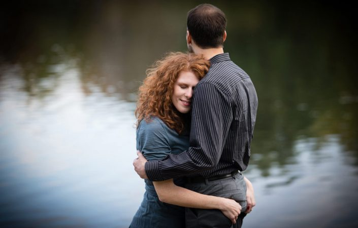 Curly brown haired lady lovingly hug his man | Anne Lord Photography