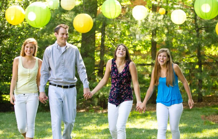 Siblings under colorful round paper lanterns | Anne Lord Photography