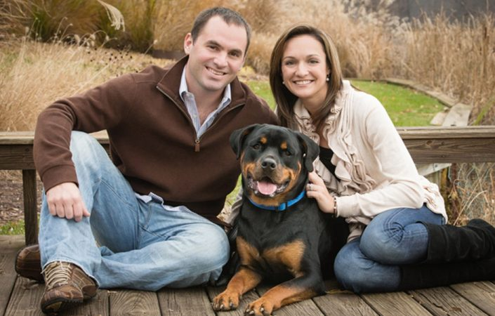 Couple with their Rottweiler dog in the middle | Anne Lord Photography