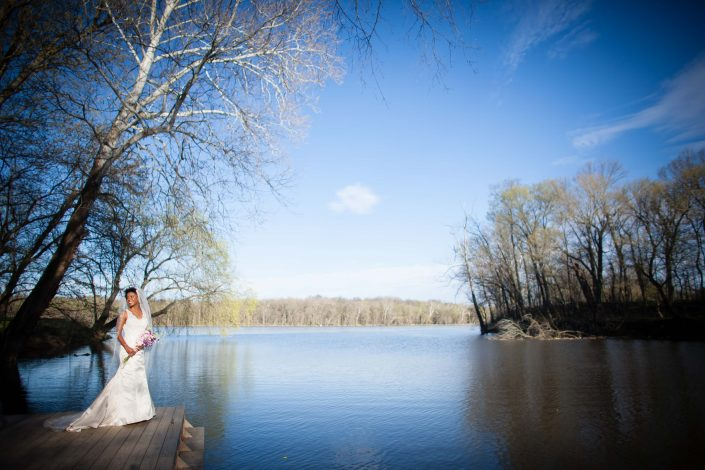 Bride in a fantastic lake view | Anne Lord Photography