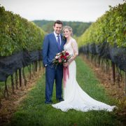 newly weds in a garden | Anne Lord Phtography