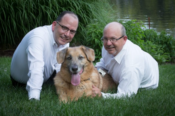 Two Gentlemen in white with their brown Dog in the middle | Anne Lord Photography