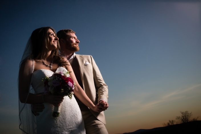 Newly wed couple both looking up in the sky | Anne Lord Photography