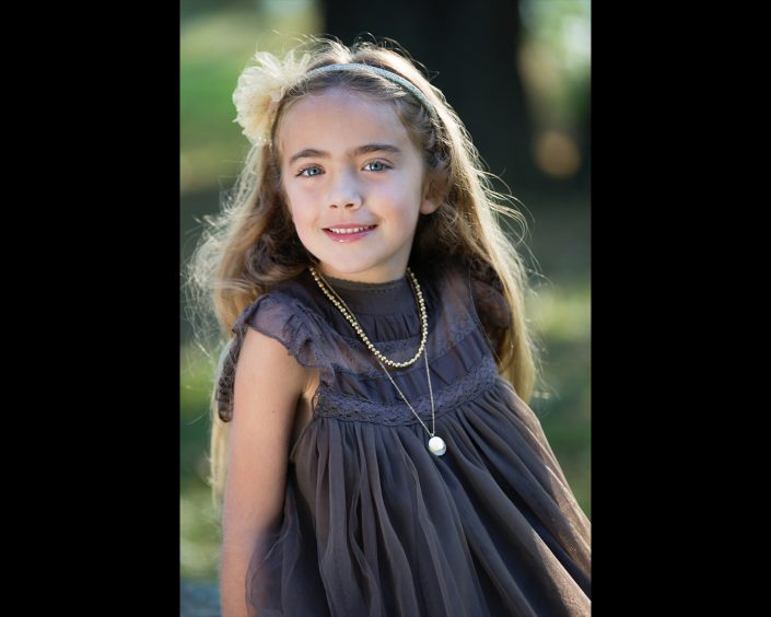 Pretty little girl wearing lacey black dress | Anne Lord Photography
