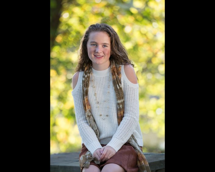 Curly haired girl wearing knitted white tops with scarf | Anne Lord Photography