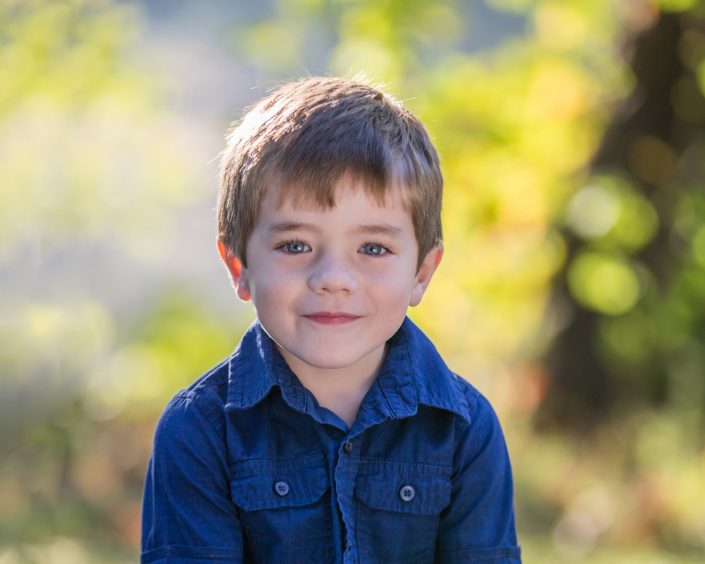Smiling little boy in blue polo shirt | Anne Lord Photography