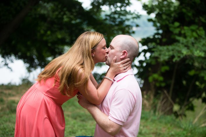 Happy Couple Girl kissing her man while wearing coral pink dress | Anne Lord Photography