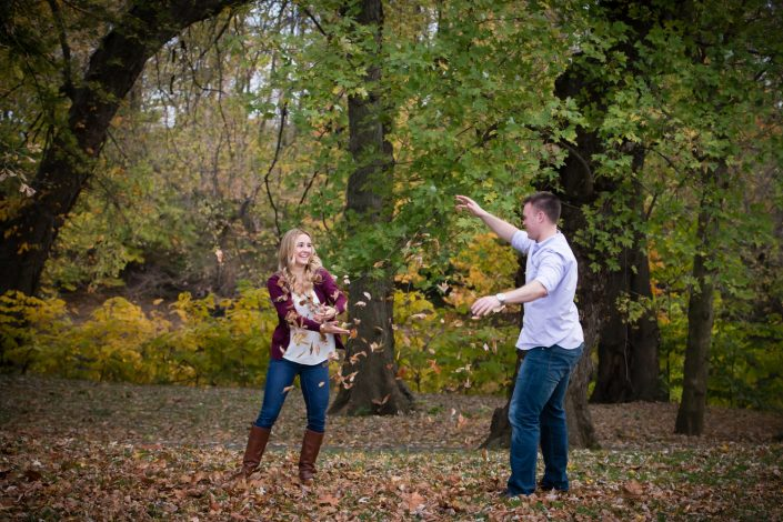 Happy Couple enjoy playing the dry leaves | Anne Lord Photography