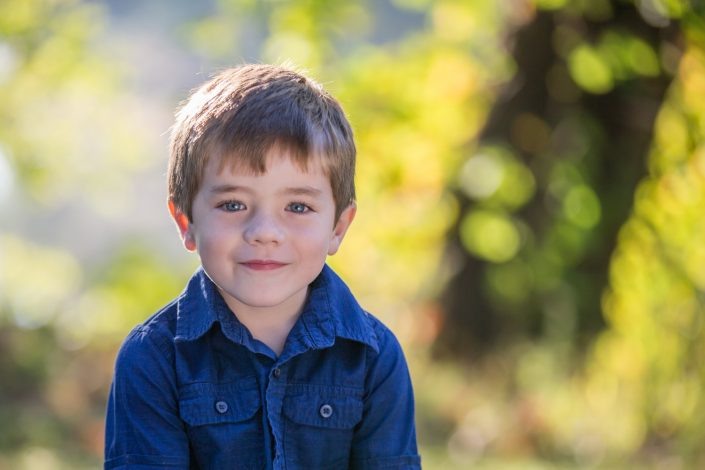 Cute little boy in blue polo shirt | Anne Lord Photography