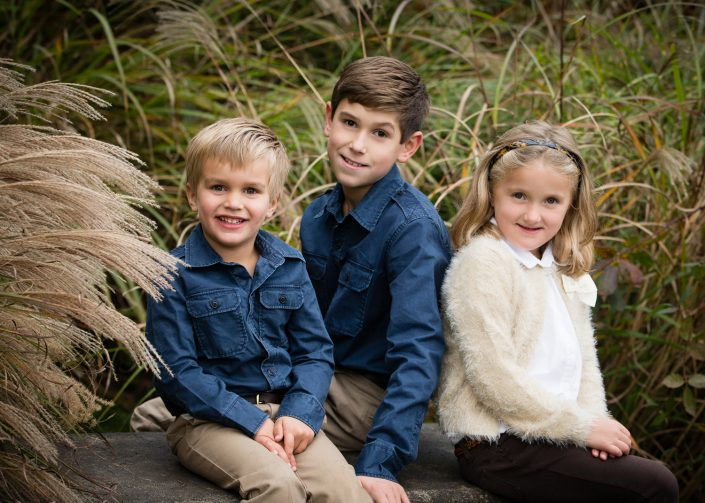 Two Little Boys and a girl wearing fury white tops | Anne Lord Photography