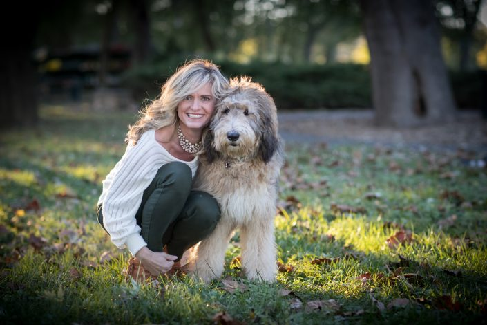 Beautiful woman hugging her furry dog | Anne Lord Photography