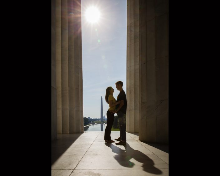 Engagement Shot of a couple beside a pillar and under the sun | Anne Lord Photography