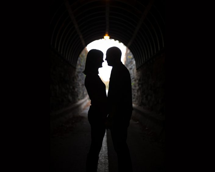 Engagement shot of a couple in a tunnel | Anne Lord Photography